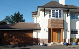 Double garage and side extension